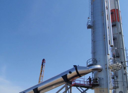 Large & Sloped Shell and Tube installed at tower base